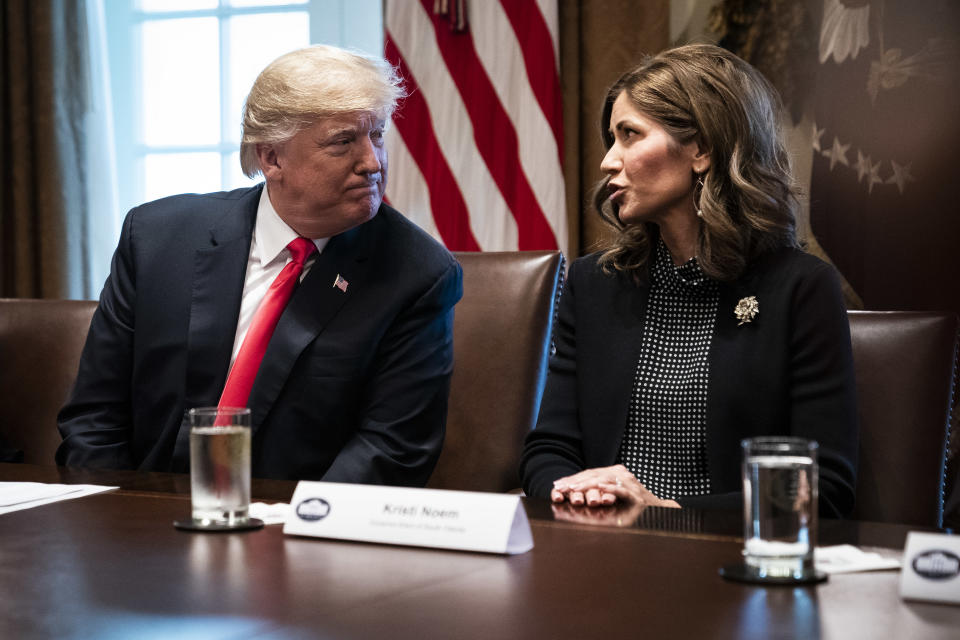WASHINGTON, DC - DECEMBER 13 : President Donald J. Trump speaks with South Dakota Gov.-elect Kristi Noem during a meeting with Governors-Elect in the Cabinet Room at White House on Thursday, Dec. 13, 2018 in Washington, DC. (Photo by Jabin Botsford/The Washington Post via Getty Images)