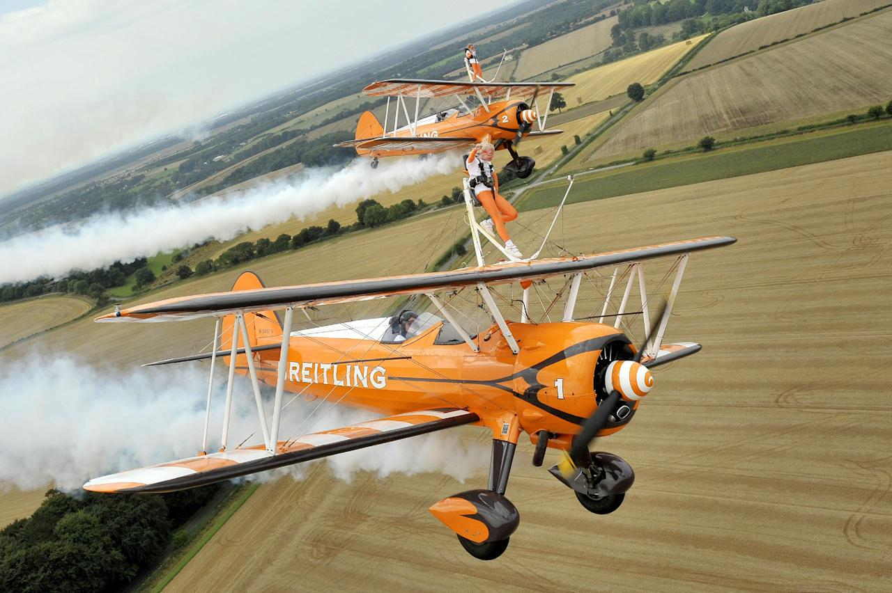 Nine-year-old cousins Rose Powell (front) and Flame Brewer wingwalking over Rendcomb Airfield near Cirencester for the charity Duchenne Children's Trust, becoming the World's youngest formation wingwalkers.