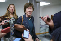 Sen. Susan Collins, R-Maine, speaks to reporters as intense negotiations continue to salvage a bipartisan infrastructure deal, at the Capitol in Washington, Tuesday, July 27, 2021. (AP Photo/J. Scott Applewhite)