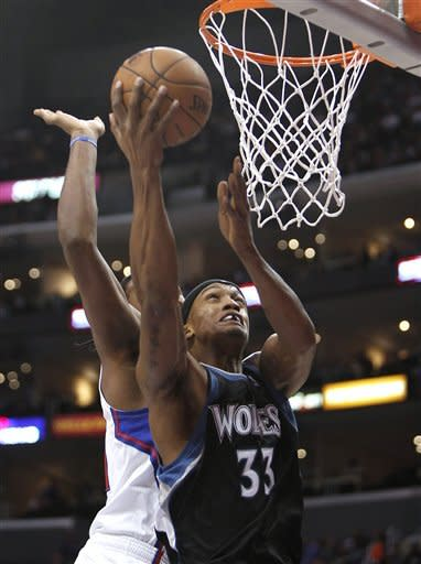Minnesota Timberwolves forward Dante Cunningham goes to the basket during the first half of an NBA basketball game against the Los Angeles Clippers in Los Angeles, Wednesday, Nov. 28, 2012. (AP Photo/Christine Cotter)