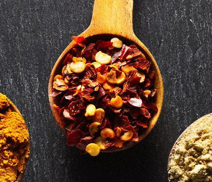 """<div class=""""caption-title""""><b>Trim Down With Crushed Red Pepper<br></b>Its metabolism-boosting properties (and heat) come from the capsaicin in the chiles. Plus, a study found women who added 2 tsp of the spice to their food took in fewer cals and fat in later meals. Stir into guac and pasta.</div> <p><br>Photo by: Jonathon Kambouris</p> <p><b>More from <i>SELF</i>:</b> <br> <a href=""""http://www.self.com/health/2013/08/ways-to-rev-your-metabolism-slideshow?mbid=synd_yshine"""" rel=""""nofollow noopener"""" target=""""_blank"""" data-ylk=""""slk:Secrets To Firing Up Your Metabolism"""" class=""""link rapid-noclick-resp"""">Secrets To Firing Up Your Metabolism</a></p>"""