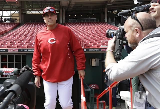 Cincinnati Reds manager Bryan Price walks onto the field prior to their opening day baseball game against the St. Louis Cardinals, Monday, March 31, 2014, in Cincinnati. (AP Photo/Al Behrman)