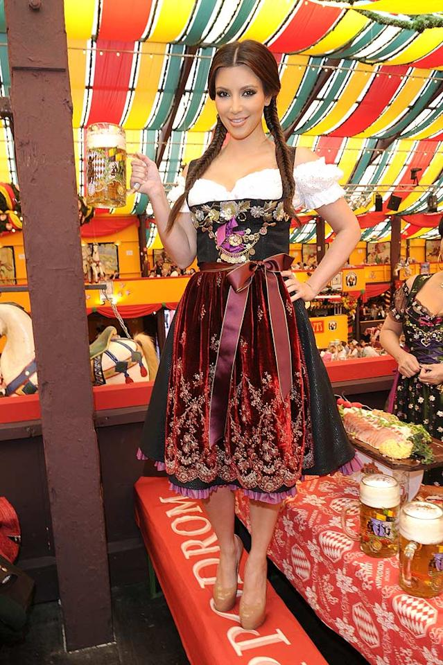 "The curvaceous reality star looked like she was trying out to become the new St. Pauli Girl in the traditional German dirndl and fishtail braids she donned for the festivities. (Her nude Louboutin pumps weren't so traditional.) Toni Passig/<a href=""http://www.wireimage.com"" target=""new"">WireImage.com</a> - September 22, 2010"