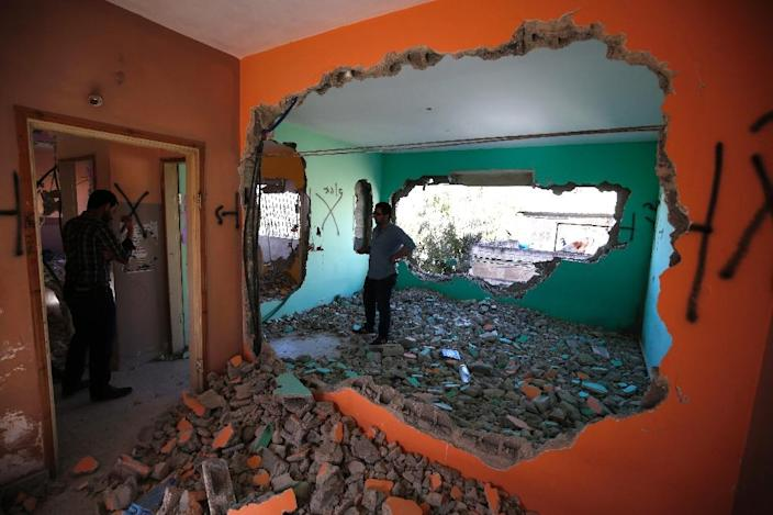 The demolition occurred overnight on April 19/20, 2016 at the apartment of Hussein Abu Ghosh in Qalandia, near Ramallah (AFP Photo/Abbas Momani)
