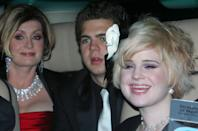 Kelly Osbourne (R) arrives with her mother Sharon (L) and brother Jack for the party to celebrate the civil ceremony of [British pop star Elton John and David Furnish] in Windsor, southern England December 21, 2005. [John tied the knot with long-term partner Furnish on Wednesday, joining hundreds of gay couples in England taking advantage of a new law to formalise their relationships.]