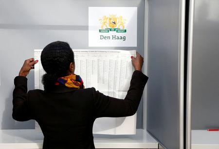 A woman votes in the Dutch general election in The Hague