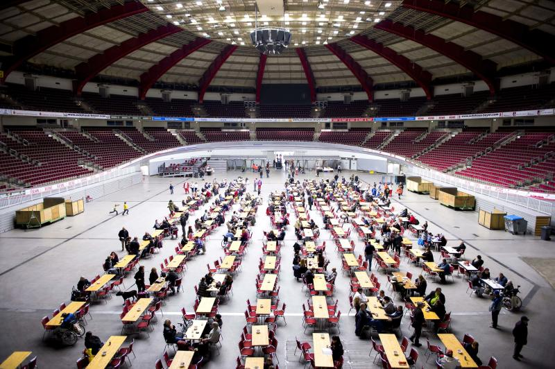 Evacuated people wait in the Westfalen Halle hall in Dortmund, Germany, Sunday Nov. 3, 2013. More than 20,000 people are being evacuated from their homes in the west German city of Dortmund as authorities prepare to defuse a massive bomb left over from World War II. The 4,000-pound (1,800-kilogram) bomb was discovered after experts analyzed old aerial photographs while searching for unexploded ordnance dropped by Allied aircraft over Germany's industrial Ruhr region. (AP Photo/dpa,Marcus Simaitis)