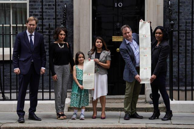 Gabriella and Richard Ratcliffe and supporters hand in a petition to 10 Downing Street to mark the 2,000th day of Ms Zaghari-Ratcliffe's detention