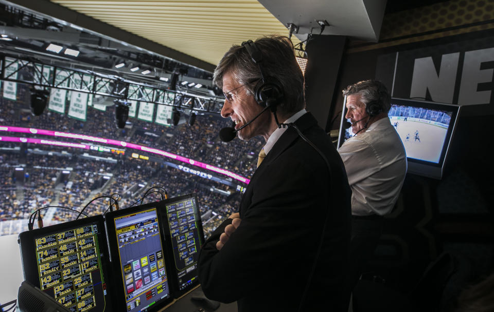 BOSTON - JANUARY 5: NESN play-by-play announcer Jack Edwards, left, and analyst Andy Brickley broadcast during a Boston Bruins game at TD Garden in Boston on Jan. 5, 2019. A team of on-air talent, camera operators, producers, and numerous others work together to make NESN's live broadcasts of Boston Bruins hockey a reality. (Photo by Stan Grossfeld/The Boston Globe via Getty Images)