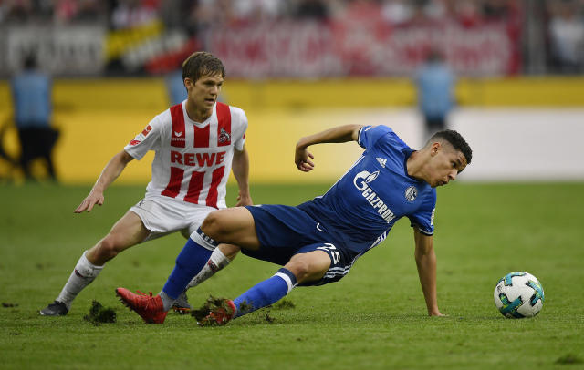 Cologne's Vincent Koziello and Schalke's Amine Harit challenge for the ball during the German Bundesliga soccer match between 1. FC Cologne and FC Schalke 04 in Cologne, Germany, Sunday, April 22, 2018. (AP Photo/Martin Meissner)