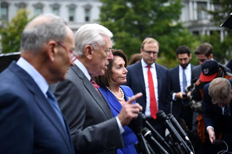 Speaker of the House Nancy Pelosi (R), Senate Minority Leader Chuck Schumer (D-NY) (C) and Representative Steny Hoyer, speak with the media after meeting with US President Donald Trump at the White House in Washington on Oct. 16, 2019. (Photo: Brendan Smialowski/AFP via Getty Images)