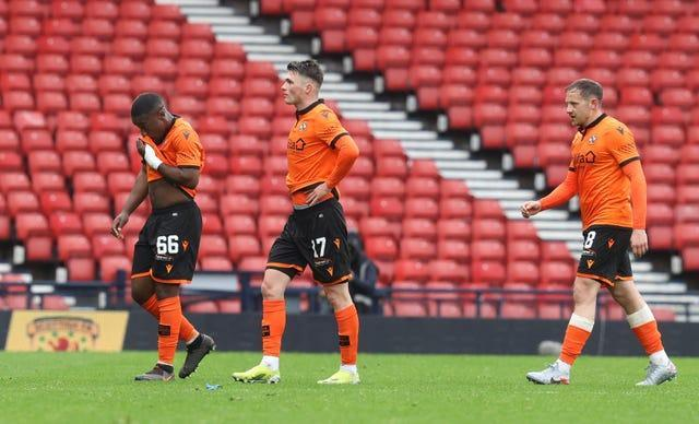 Dundee United players leave the field dejected