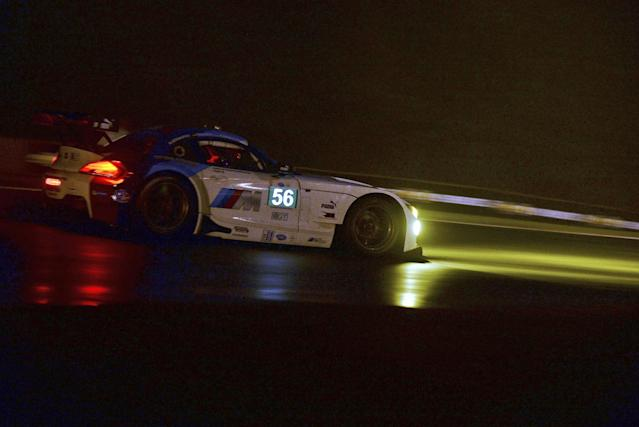 Dirk Muller, of Germany, drives a BMW Z4 GTE during night practice for the American Le Mans Series' Petit Le Mans auto race at Road Atlanta, Thursday, Oct. 17, 2013, in Braselton, Ga. (AP Photo/Rainier Ehrhardt)