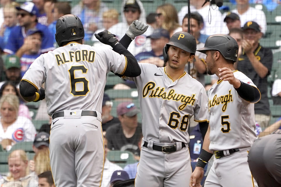 CORRECTS TO TWO-RUN HOME RUN, NOT A THREE-RUN - Pittsburgh Pirates' Anthony Alford (6) celebrates after his two-run home run off Chicago Cubs starting pitcher Alec Mills with Hoy Park (68) and Michael Perez during the sixth inning of a baseball game Friday, Sept. 3, 2021, in Chicago. (AP Photo/Charles Rex Arbogast)