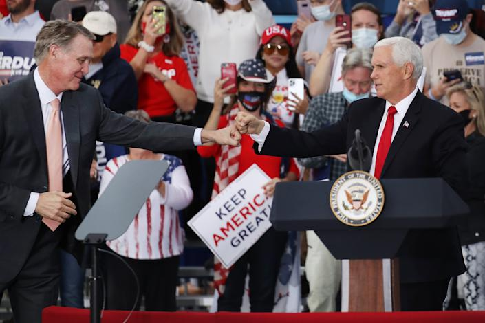 Vice President Mike Pence (right) lends his support at a rally with Sen. David Perdue (R-GA) on December 04, 2020 in Savannah, Georgia. (Spencer Platt/Getty Images)