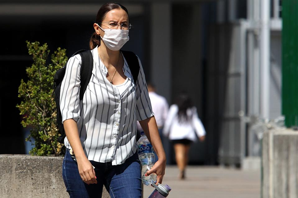 A woman walking in the streets of Guadalajara, Mexico, wears a protective face mask on February 28, 2020 as the new coronoavirus, COVID-19, spreads worldwide. (Photo:ULISES RUIZ/AFP via Getty Images)