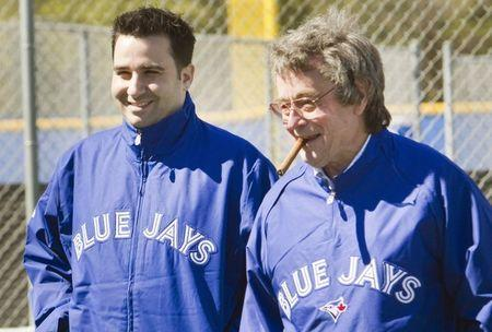 FILE PHOTO: Former Toronto Blue Jays general manager Alex Anthopoulos (L) and President and CEO of the Blue Jays Paul Beeston talk during workouts at the team's MLB baseball spring training facility in Dunedin, Florida February 17, 2013. REUTERS/Fred Thornhill