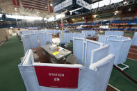 The Armory, an indoor track and field complex, is being set up as a COVID-19 vaccination center, Thursday, Jan. 14, 2021, in New York. The site is run by New York-Presbyterian Hospital and vaccinations are available by appointment through vaccinetogetherny.org. (AP Photo/Mark Lennihan)