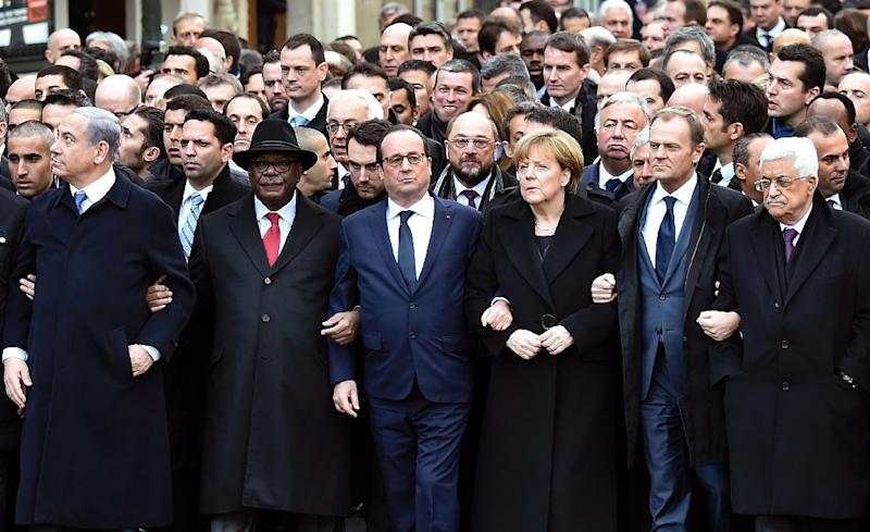 French President Francois Hollande was joined by dozens of foreign leaders in a march of solidarity in Paris following the deadly jihadist attack on the Charlie Hebdo satirical weekly in 2015 (AFP Photo/ERIC FEFERBERG)