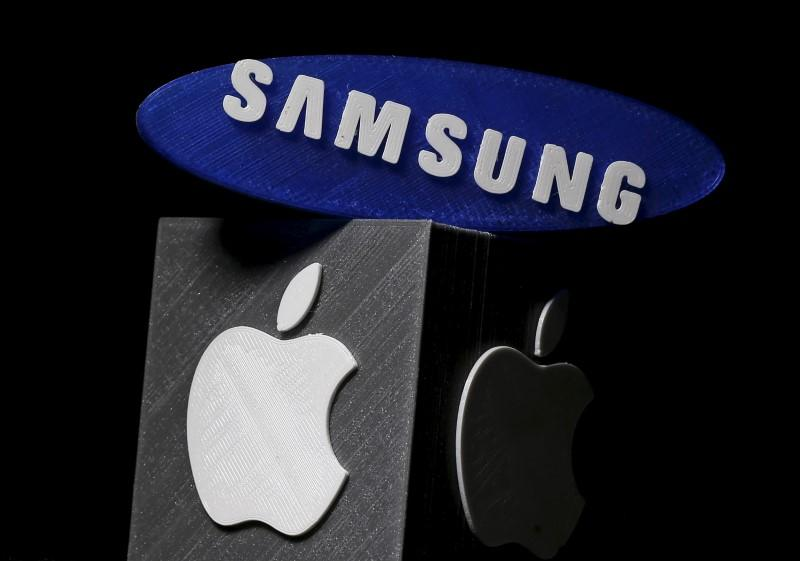 3D-printed Samsung and Apple logos are seen in this picture <a href=