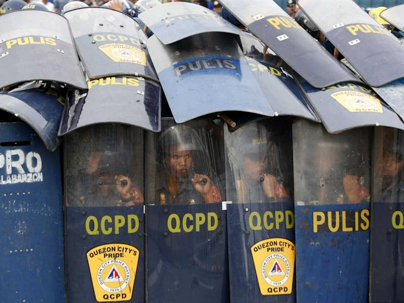 Police behind shields