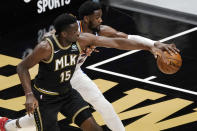 Phoenix Suns center Deandre Ayton (22) and Atlanta Hawks center Clint Capela (15) fight for a loose ball in the first half of an NBA basketball game Wednesday, May 5, 2021, in Atlanta. (AP Photo/John Bazemore)