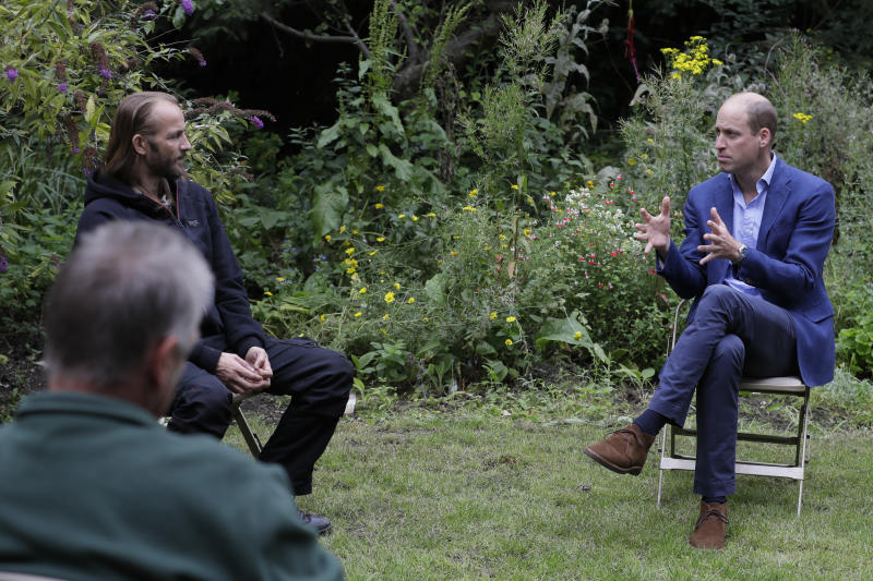 EMBARGOED TO 2200 SATURDAY JULY 18 The Duke of Cambridge speaks with service users Robert Farrand (back left) and Robert Smale (front left) during a visit to the Garden House part of the Peterborough Light Project, a charity which offers advice and support to rough sleepers.