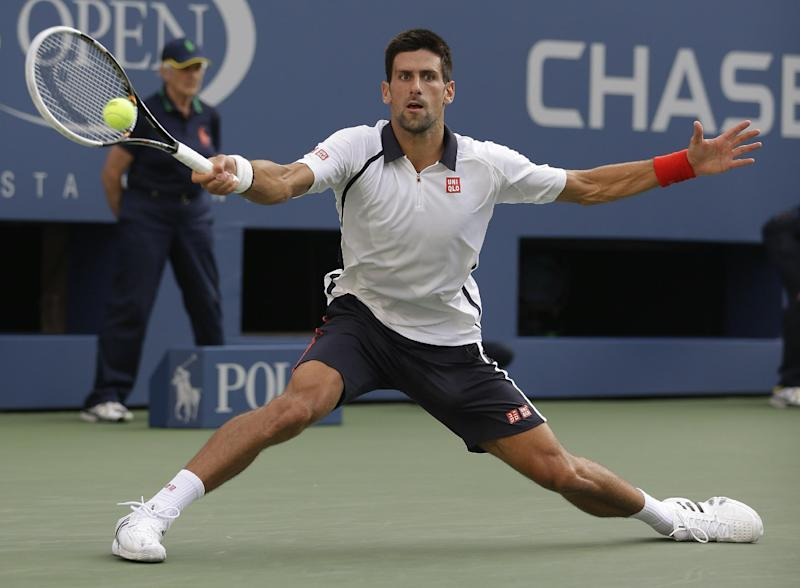 Serbia's Novak Djokovic returns a shot to Spain's David Ferrer during a semifinal match at the 2012 US Open tennis tournament,  Saturday, Sept. 8, 2012, in New York. The U.S. Open will finish on a Monday for the fifth consecutive year. With a potentially dangerous storm expected Saturday night in Flushing Meadows, the tournament suspended play for the day while David Ferrer was leading Novak Djokovic 5-2 in the first set of their semifinal. (AP Photo/Darron Cummings)