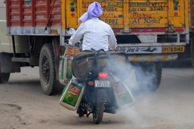 With more than 8.5 million vehicles on Delhi's roads and 1,400 new cars being added every day, city authorities will have their work cut out to reduce pollution (AFP Photo/Money Sharma)