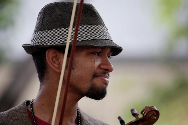 <p>Venezuelan violinist Wuilly Arteaga reacts during a gathering against Venezuela's President Nicolas Maduro's government in Caracas, Venezuela June 4, 2017. (Photo: Marco Bello/Reuters) </p>