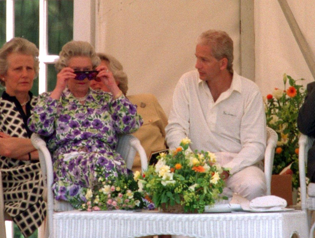 23 JUN 1994:  QUEEN ELIZABETH OF GREAT BRITAIN AND NORTHERN IRELAND TRIES ON THE SPECIALLY DESIGNED SUNGLASSES USED BY THE EX-ENGLAND CRICKET CAPTAIN DAVID GOWER (RIGHT) DURING THE VISITING SOUTH AFRICAN CRICKET TEAM FIRST MATCH ON BRITISH SOIL FOR 29 YEA