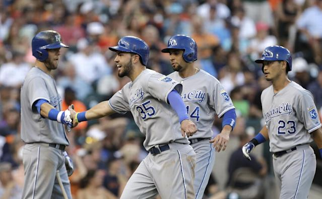 Kansas City Royals' Eric Hosmer (35) celebrates with Alex Gordon, left, as Omar Infante (14) and Norichika Aoki (23) look on after a Billy Butler double against the Detroit Tigers in the fifth inning of a baseball game in Detroit, Monday, June 16, 2014. (AP Photo/Paul Sancya)