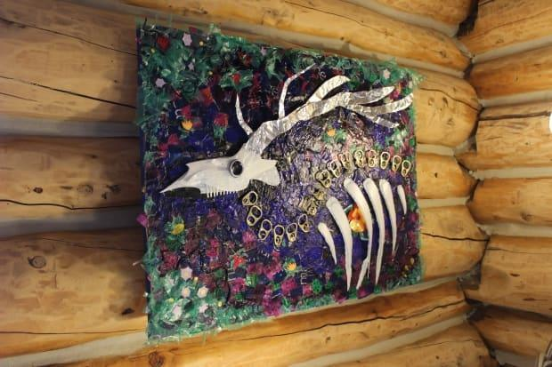 Wildlifeless by Emma Merlyn Butler hangs on one of the walls of the Wildcat Café in Yellowknife's Old Town neighbourhood. The space is being transformed into an artists centre until the end of September. (Liny Lamberink/CBC - image credit)