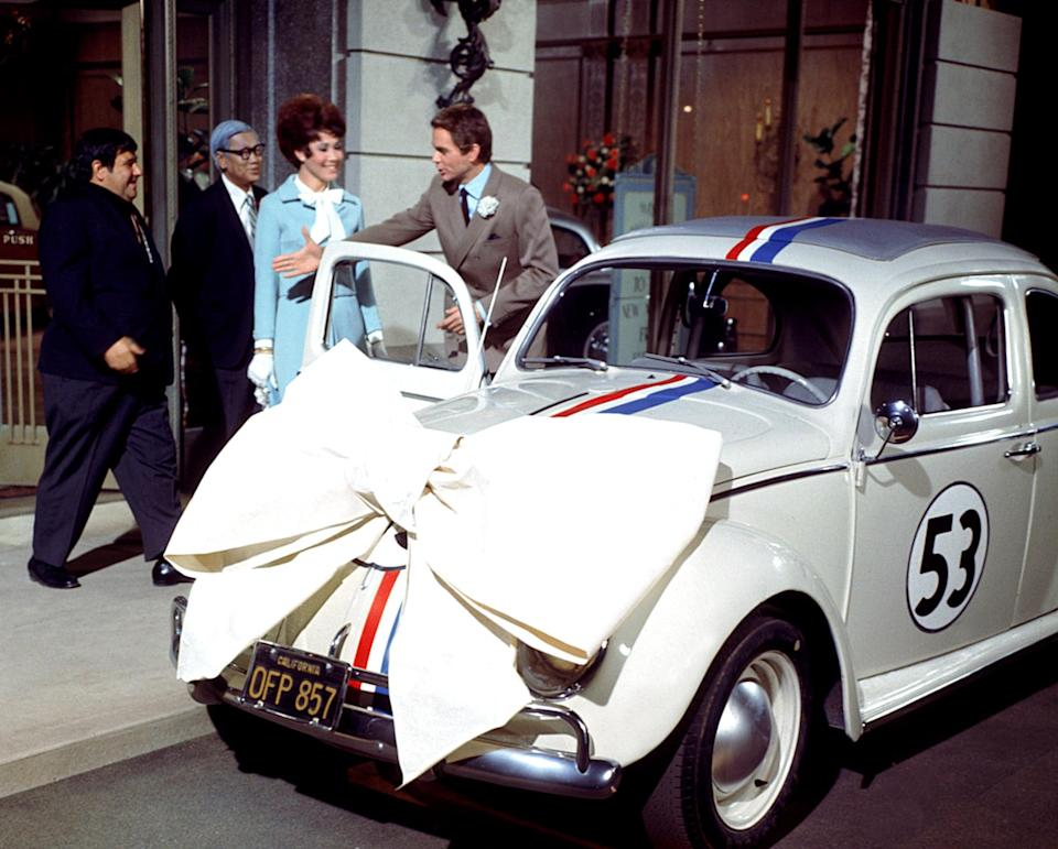 """<p>A low-key race car driver and his mechanic best friend end up owning a quirky VW Beetle that seems to have a personality of its own. The duo and their new car, named """"Herbie,"""" soar to the top of their sport, which puts them squarely in the crosshairs of an unscrupulous car dealer. It's a sweetly cheesy throwback movie with '60s retro flair.</p> <p><a href=""""http://www.disneyplus.com/movies/the-love-bug-1969/BY2ghqXC1pId"""" class=""""link rapid-noclick-resp"""" rel=""""nofollow noopener"""" target=""""_blank"""" data-ylk=""""slk:Watch The Love Bug on Disney+."""">Watch <strong>The Love Bug</strong> on Disney+.</a></p>"""
