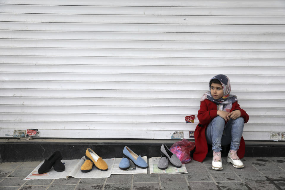 """A vendor waits for customers ahead of the Persian New Year, or Nowruz, meaning """"New Day."""" at Tajrish traditional bazaar in northern Tehran, Iran, Wednesday, March 17, 2021. (AP Photo/Ebrahim Noroozi)"""