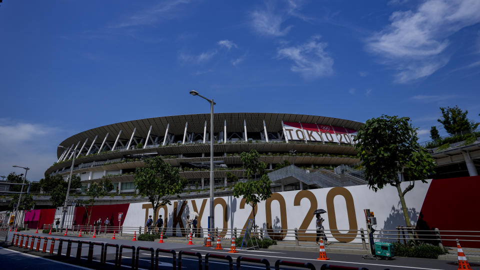 National Stadium, where the opening and closing ceremonies for the Olympics will be held, is branded with