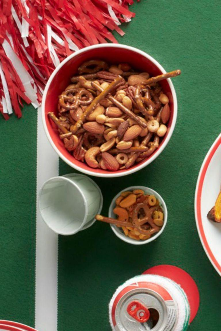 """<p>The kids are going to love coming home to this homemade trail mix in little bags, which makes for easy clean up. </p><p><em><a href=""""https://www.womansday.com/food-recipes/food-drinks/recipes/a53329/snack-mix/"""" rel=""""nofollow noopener"""" target=""""_blank"""" data-ylk=""""slk:Get the Snack Mix recipe."""" class=""""link rapid-noclick-resp"""">Get the Snack Mix recipe.</a></em></p>"""