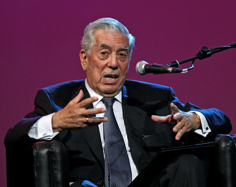 "FILE - This April 21, 2011 file photo shows Nobel Literature Prize laureate Mario Vargas Llosa, of Peru, speaking during a conference at the annual book fair in Buenos Aires, Argentina. Varhas Llosa was a guest speaker at the Americas Society, Monday, Nov. 12, 2012 to discuss his latest novel ""The Dream of the Celt.""  He says he has tried to write erotic novels ""without the same success"" as EL James, who wrote the best-selling ""Fifty Shades of Grey"" trilogy. He also said he was surprised to see ""Fifty Shades"" books at the window displays of bookstores in Ireland, where he presented his latest novel ""The Dream of Celt"" in June. James' erotic novels are currently bestsellers in Argentina, Mexico, Spain, Chile and Colombia, among other Spanish-speaking countries.(AP Photo/Natacha Pisarenko, file)"