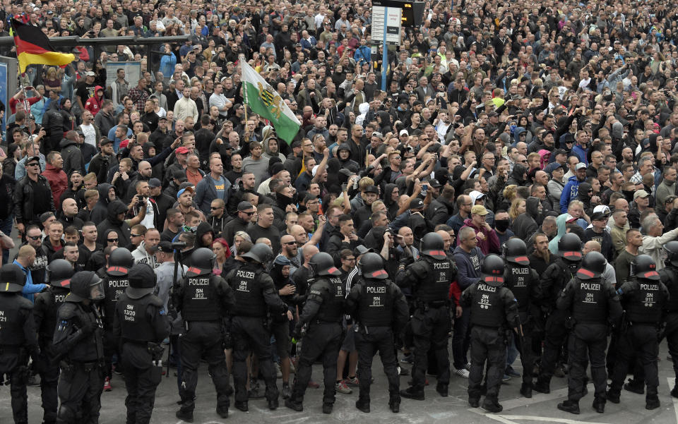 """FILE - In this Monday, Aug. 27, 2018 file photo, demonstrators shout during a far-right protest in Chemnitz, Germany, after a man died and two others were injured in an altercation between several people of """"various nationalities"""" in the eastern German city of Chemnitz the previous day. In September 2021, there were at least 54 Facebook profiles belonging to 39 entities that the German government and civil society groups have flagged as extremist, according to research shared with The Associated Press by the Counter Extremism Project, a non-profit policy and advocacy group formed to combat extremism. The groups have nearly 268,000 subscribers and friends on Facebook alone. (AP Photo/Jens Meyer, File)"""