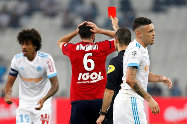 Soccer Football - Ligue 1 - Olympique de Marseille vs Amiens SC - Orange Velodrome, Marseille, France - May 19, 2018 Amiens' Thomas Monconduit is shown a red card by referee Jerome Brisard REUTERS/Philippe Laurenson
