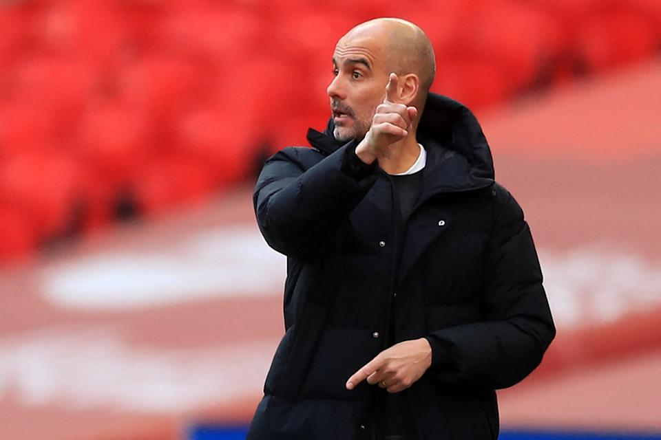 Manchester City's Spanish manager Pep Guardiola gestures on the touchline during the English FA Cup semi-final football match between Chelsea and Manchester City at Wembley Stadium in north west London on April 17, 2021. - - NOT FOR MARKETING OR ADVERTISING USE / RESTRICTED TO EDITORIAL USE (Photo by Adam Davy / POOL / AFP) / NOT FOR MARKETING OR ADVERTISING USE / RESTRICTED TO EDITORIAL USE (Photo by ADAM DAVY/POOL/AFP via Getty Images)