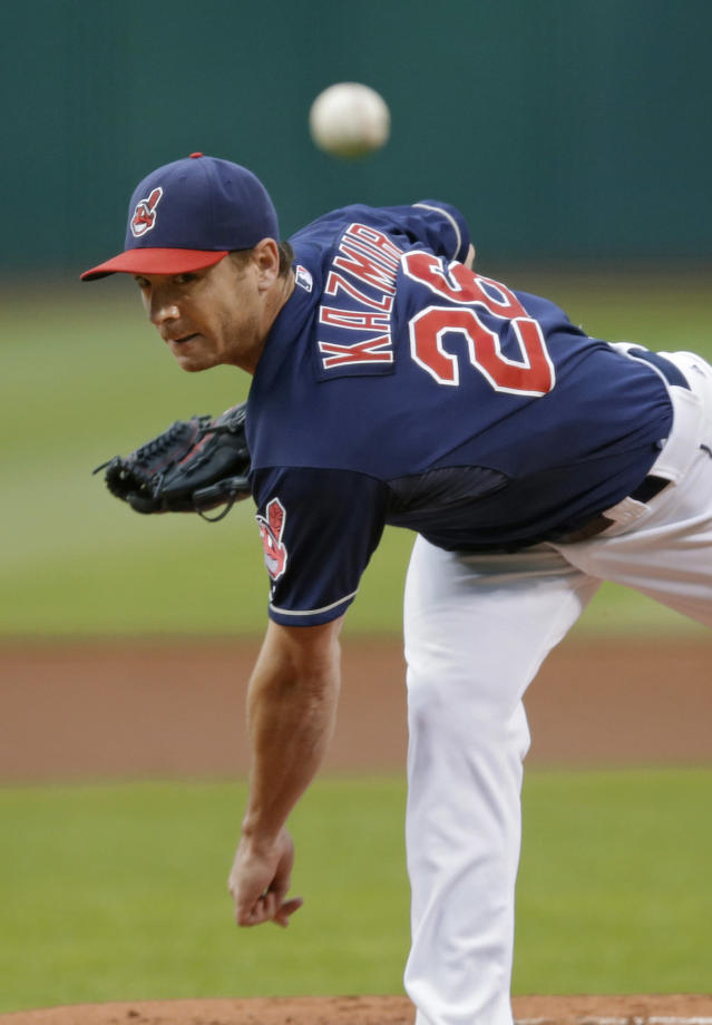 Cleveland Indians starting pitcher Scott Kazmir delivers against the New York Mets in the first inning of a baseball game Friday, Sept. 6, 2013, in Cleveland. (AP Photo/Mark Duncan)