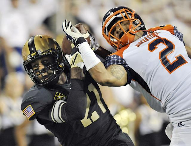 Army wide receiver Chevaughn Lawrence (21) catches a pass for a touchdown while being defended by Morgan States defensive back Joe Rankin (2) during the first half of an NCAA college football game on Friday, Aug. 30, 2013, in West Point, N.Y. (AP Photo/Hans Pennink)