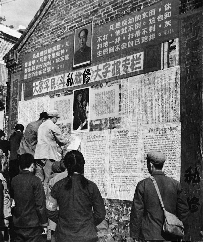 """""""Big character posters"""" are put up by peasants and soldiers, circa 1970."""