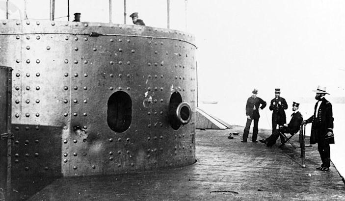 View on the deck of USS <i>Monitor</i> looking forward on the starboard side, while the ship was in the James River, Va., July 9, 1862. At left is the turret, with the muzzle of one of the ship's two XI-inch Dahlgren smoothbore guns. Dents in turret armor are from hits by Confederate heavy guns.