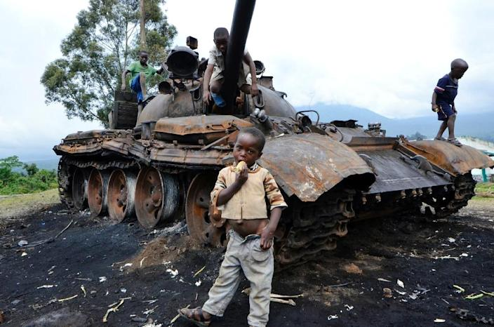 The remains of a tank that had belonged to M23 rebel soldiers, seen in October 2013, a day after Congolese army troops captured the last rebel stronghold (AFP Photo/Junior D. Kannah)