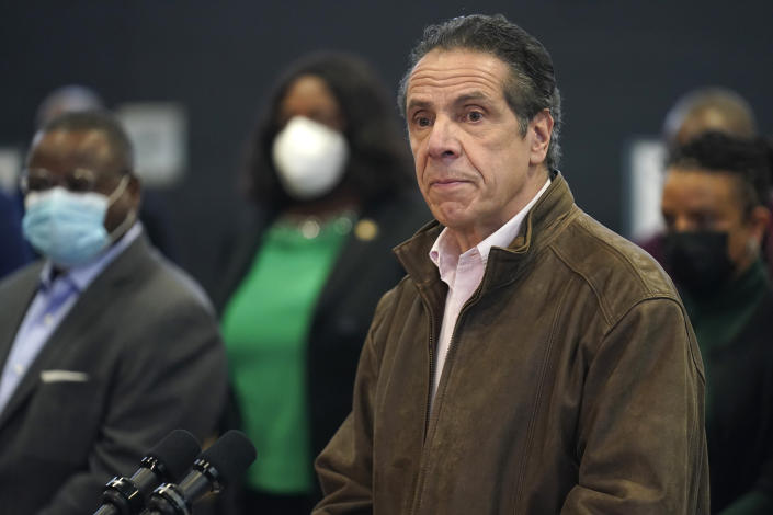 FILE - In this Feb. 22, 2021 photo, New York Gov. Andrew Cuomo, right, pauses to listen to a reporter's question during a news conference at a COVID-19 vaccination site in the Brooklyn borough of New York. New York's attorney general said she's moving forward with an investigation into sexual harassment allegations against the governor after receiving a letter from his office Monday authorizing her to take charge of the probe. (AP Photo/Seth Wenig, Pool, file)