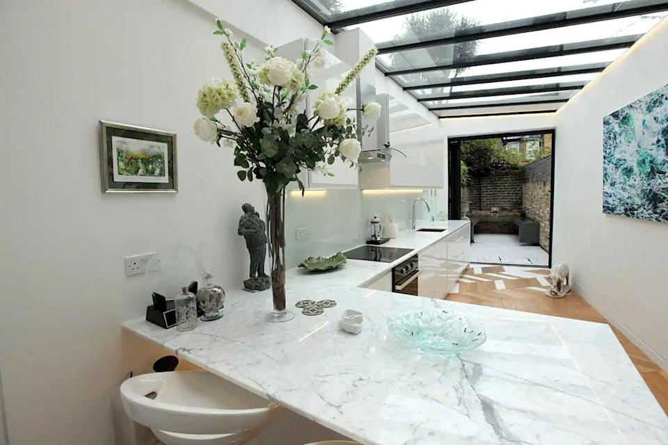 """<p>A beautifully designed flat brought to you by a creative host, this Notting Hill garden rental sits close to Portobello Market, the restaurants and bars we love about the desirable area. There's a private entrance with a secured front gate and the interior is light and airy, with a sun-kissed courtyard garden. Those who like to cook will adore the kitchen, while the integral Sonus music system and two smart TVs ensure you're entertained.</p><p><strong>Sleeps:</strong> Two</p><p><strong>Price per night: </strong>£150.00</p><p><a class=""""link rapid-noclick-resp"""" href=""""https://airbnb.pvxt.net/15Gy6m"""" rel=""""nofollow noopener"""" target=""""_blank"""" data-ylk=""""slk:SEE INSIDE"""">SEE INSIDE</a></p>"""
