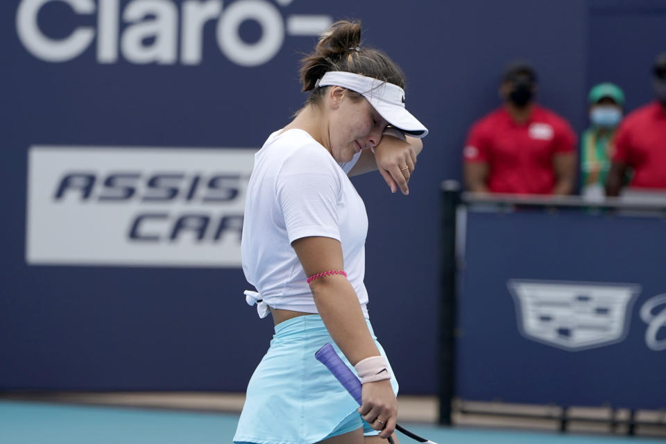 Bianca Andreescu of Canada walks off the court as she retired during her finals match against Ashleigh Barty of Australia at the Miami Open tennis tournament, Saturday, April 3, 2021, in Miami Gardens, Fla. Barty won 6-3, 4-0, as Andreescu retired due to injury. (AP Photo/Lynne Sladky)