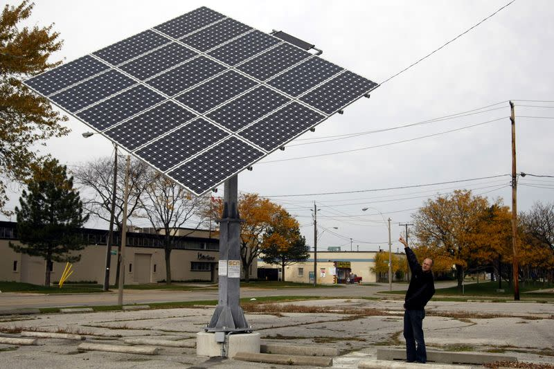 FILE PHOTO: Green Sun Rising president Klaus Dohring shows a solar tracker in the parking lot of a former auto parts plant in Windsor, Ontario